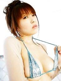 Sensual gravure idol babe with big plump boobs in a bikini