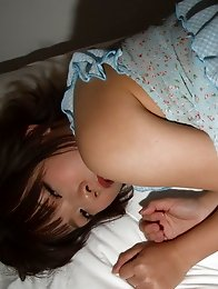Cute and sexy Japanese av idol Mana Sakura lies on bed showing off her lovely breasts