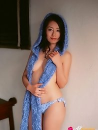 Energetic asian beauty playing on the beach in her bikini