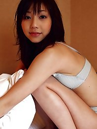 Sizzling hot asian babe looks delicious in her white lingerie