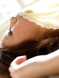 Sexy and horny Japanese av idol Natsuki Yoshinaga shows her slim naked body