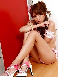 Cute asian hottie with big plump tits in a pink bikini