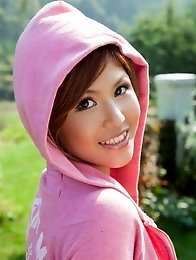 Sexy japan girl Pine Shizuku in a pink jacket stripping on green lawn outdoors