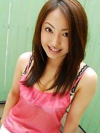 Japanese av idol Mami Asakura takes off her panties and shows her hairy pussy