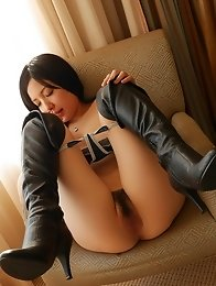 Sexy and horny Japanese av idol Airi Minami masturbates on the couch
