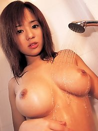 Busty naked asian hottie shows off her huge delicious melons