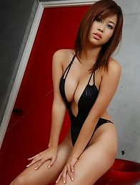 Sexy asian babe sizzles in her black one piece swim suit