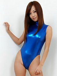 Beautiful gravure idol with long sexy legs in a blue swim suit