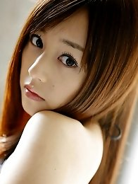 Tantilizing asian beauty steams up the place in her lingerie