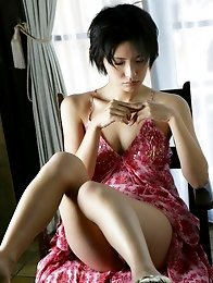Mari Hoshino is a sexy glamour model posing in her minidress