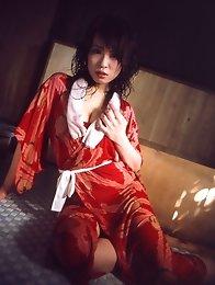 Nozomi Takeuchi poses as naughty nurse stripping off her uniform